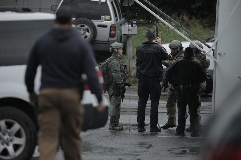 Anchorage police prepare to deploy a gas canister during a standoff near Lore Road and Rancho Drive on Friday. (Loren Holmes / Alaska Dispatch News)