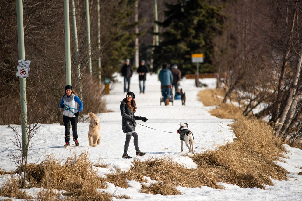 People recreate on the Chester Creek Trail at Westchester Lagoon on Thursday, April 9, 2020. (Loren Holmes / ADN)