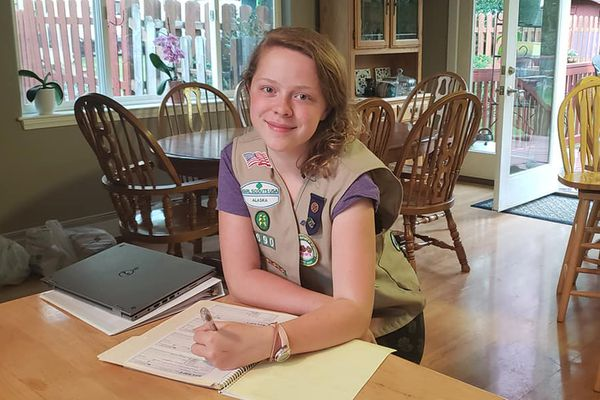 Alaina Vik writes receipts for donations to her Operation Sweet Support project, which sends care packages to U.S. troops deployed overseas. (Photo provided by Amy and Curtis Vik)