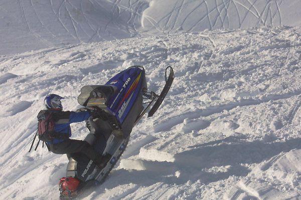 A man runs his snowmobile up a hill at Turnagain Pass. (AP file)