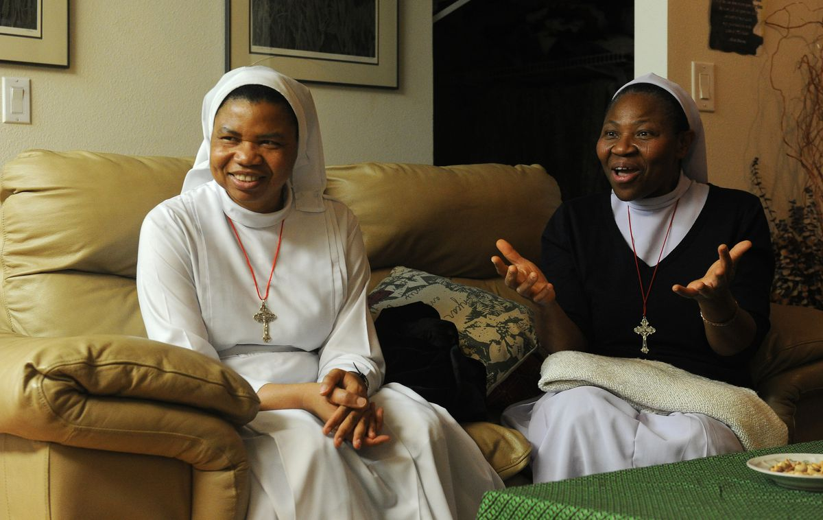 Sisters Angela Omoareghan and Genevieve Osayame, from Nigeria, are in Anchorage, AK on a mission on Wednesday, Nov. 7, 2018. (Bob Hallinen / ADN)