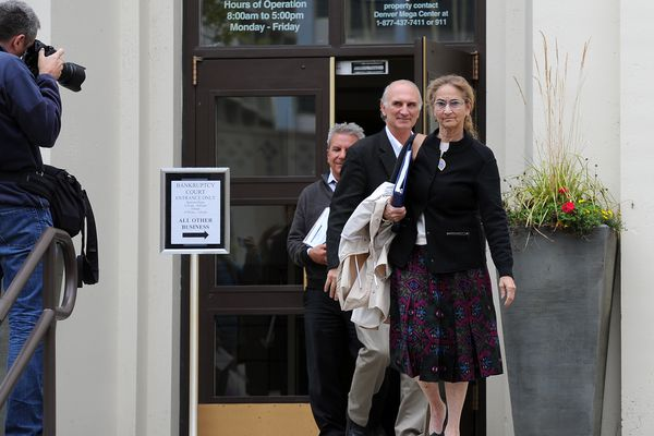 Alaska Dispatch News owner Alice Rogoff departs a creditors meeting in the ADN bankruptcy case trailed by ADN attorney Cabot Christianson and Northrim Bank attorney Michael Parise on Thursday, September 7, 2017, at the Old Federal Building downtown. (Erik Hill / Alaska Dispatch News)