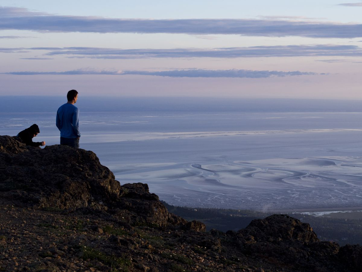 Flattop Mountain, overlooking Anchorage in Chugach State Park, attracts hikers annually on the evening of summer solstice. (Marc Lester/ADN/archive)