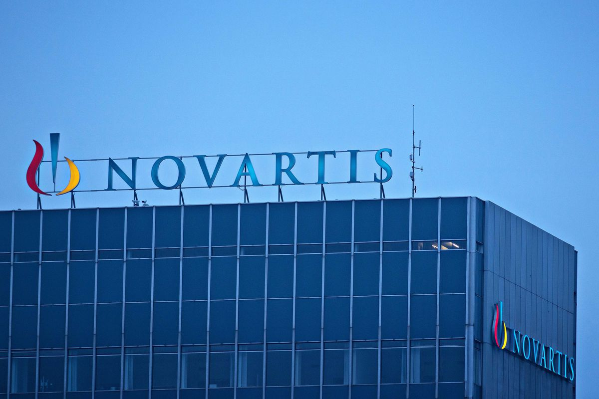 The Novartis AG Logo sits on top of the company's headquarters office in Basel, Switzerland. (Bloomberg photo by Michele Limina)