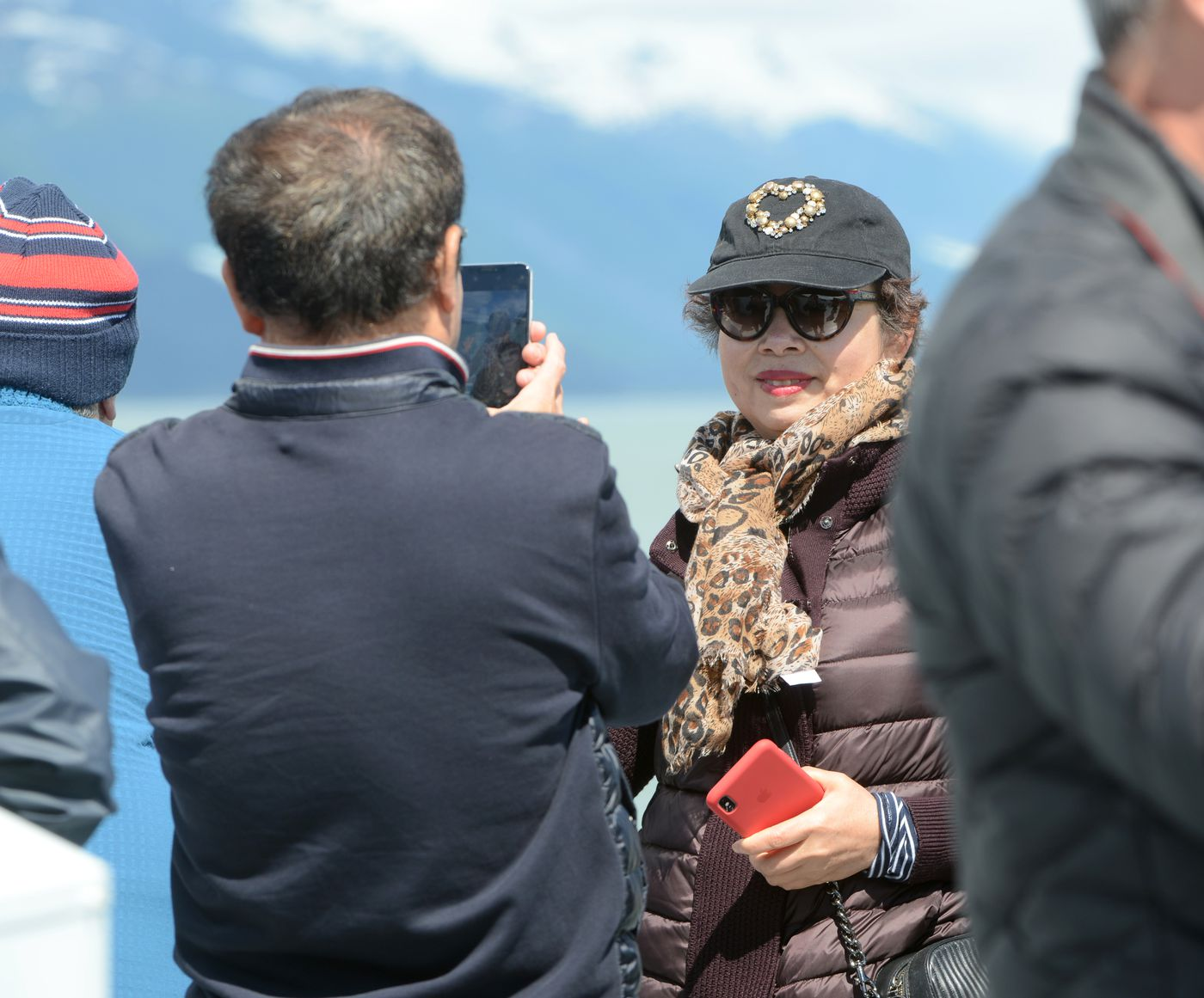 Qin Li takes a picture of his wife Guilang Xing aboard the Klondike Express. (Anne Raup / ADN)