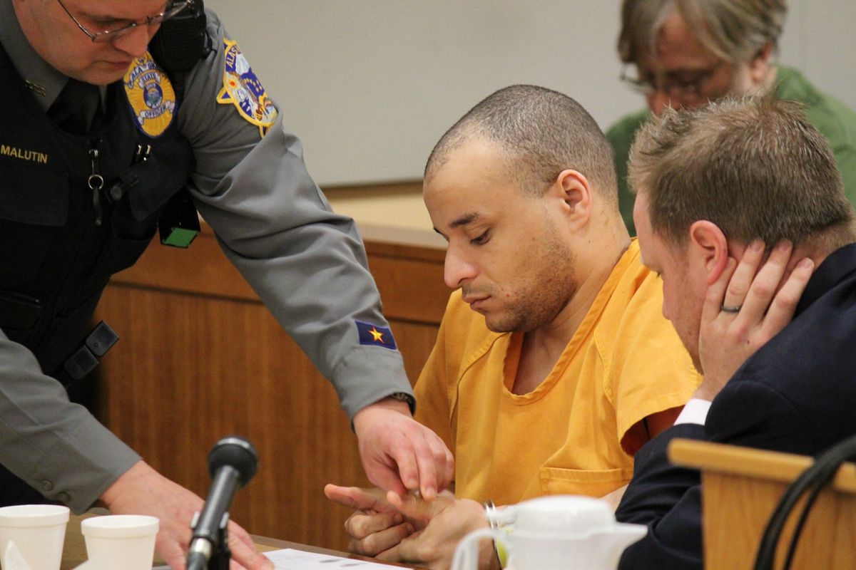 A court officer fingerprints Terence Gray, 33, in Anchorage Superior Court on Friday, Jan. 30, 2015. A jury found Gray guilty of second-degree murder in July for shooting Edwing Matos to death inside the Dimond Center.