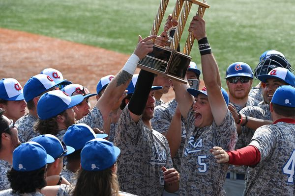 Anchorage Glacier Pilots first baseman Garrett Ostrander hoists the Mayors Cup at Mulcahy Stadium on Sunday, July 18, 2021, after their 5-3 victory over the Anchorage Bucs to retain the Mayors Cup they won in 2019. The Pilots won the first game of the series, 6-4 in 10 innings on Friday, and the Bucs knotted things up with a 3-2 win Saturday. (Bill Roth / ADN)