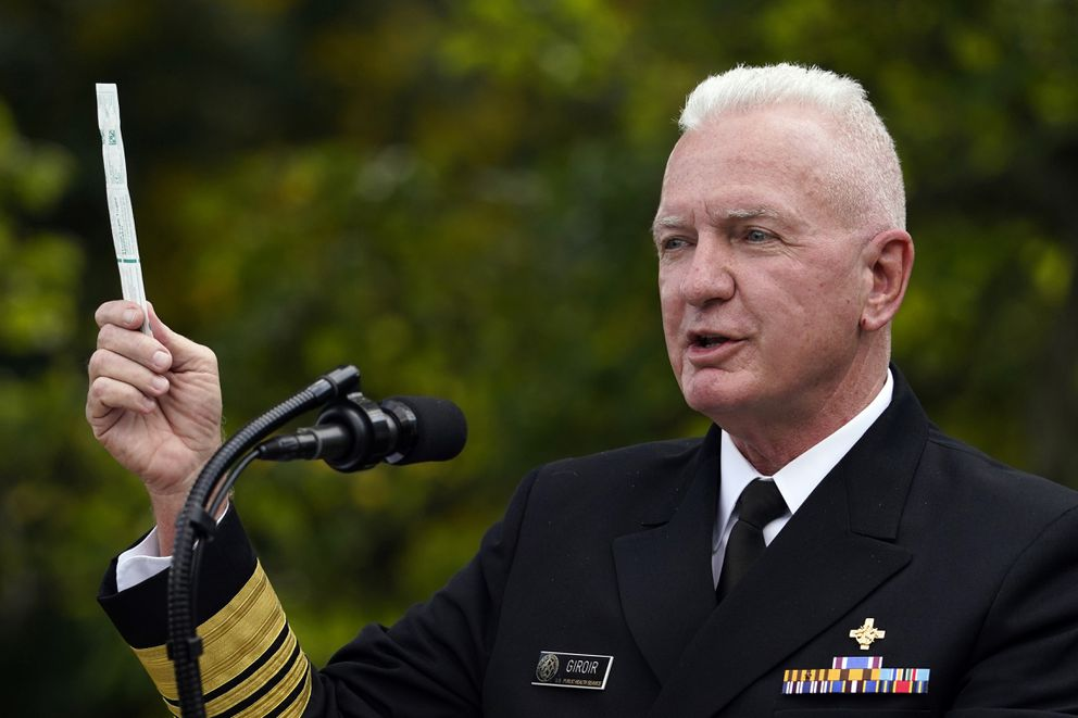 Adm. Brett Giroir, assistant secretary of Health and Human Services, holds a coronavirus test swab during a event in September. (AP Photo/Evan Vucci, File)