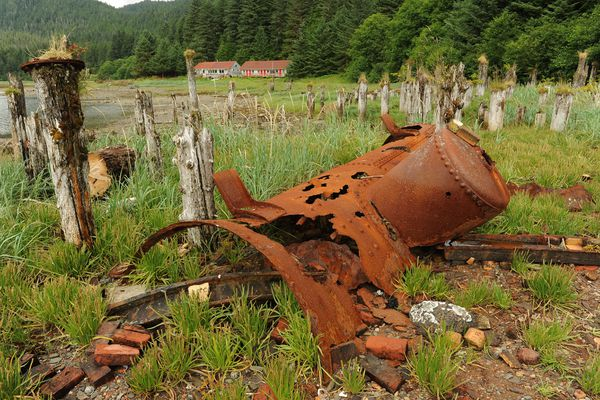 A rusted out boiler lies among pilings at the site of the San Juan Fishing & Packing Co. cannery built in 1901 at Taku Harbor 22 miles south of central Juneau, AK on Wednesday, July 18, 2018. (Bob Hallinen / ADN)