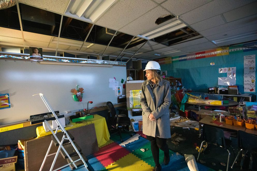 ASD superintendent Deena Bishop tours a classroom at Eagle River Elementary School on Dec. 4. The school was badly damaged in the Nov. 30 earthquake, and will remain closed for the remainder of the school year. (Loren Holmes / ADN)