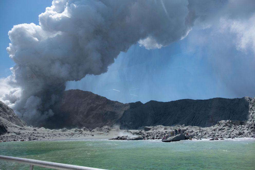 This Dec. 9, 2019, photo provided by Michael Schade, shows the eruption of the volcano on White Island, New Zealand. Unstable conditions continued to hamper rescue workers from searching for people missing and feared dead after the volcano off the New Zealand coast erupted in a towering blast of ash and scalding steam while dozens of tourists explored its moon-like surface. (Michael Schade via AP)
