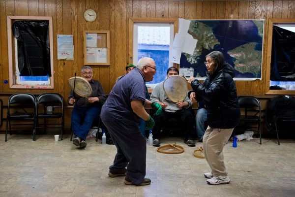 Larry Kava dances with his wife, Theresa, near the close of the evening gathering. Drummers and dancers gathered on April 23, 2017, as they do most Sunday evenings in Savoonga's city building. (Marc Lester / Alaska Dispatch News)
