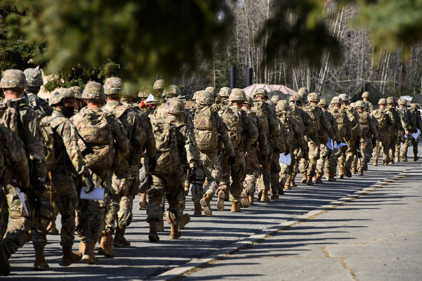 Paratroopers walk to the start of Expert Infantry Badge and Expert Soldier Badge testing on April 27, 2021, outside Attu Hall on Joint Base Elmendorf-Richardson. (Marc Lester / ADN)