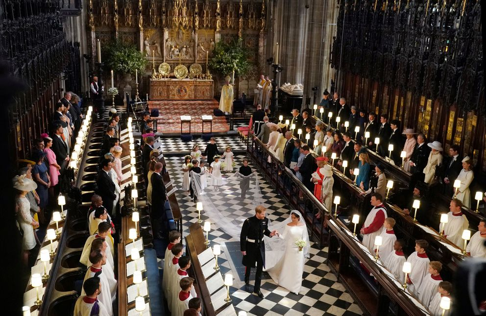 Prince Harry and Meghan Markle leave St George's Chapel in Windsor Castle after their wedding Windsor, Britain, May 19, 2018. Owen Humphreys/Pool via REUTERS