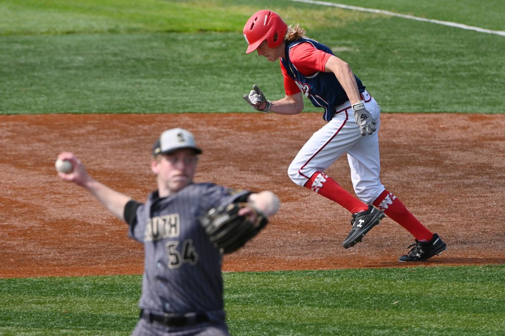 Wasilla baserunner Jacob Gilbert steals second base as South pitcher Josh McGovern throws during the Road Warriors' 11-1 victory over the Wolverines to advance to the final of the Alliance Baseball League state tournament at Mulcahy Stadium on Tuesday afternoon, July 28, 2020. (Bill Roth / ADN)