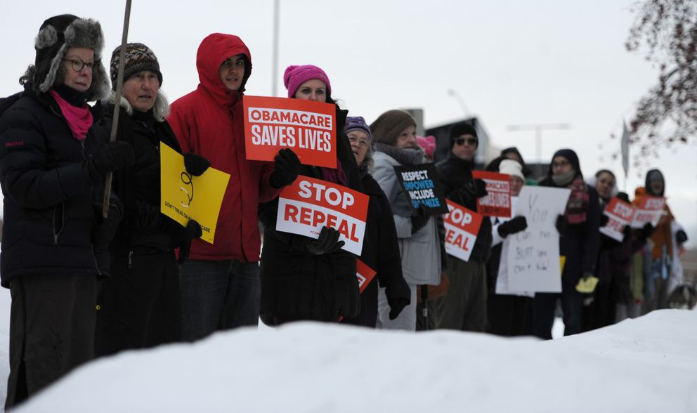 Activists encourage Sen. Dan Sullivan not to vote to repeal the Affordable Care Act on Wednesday, Feb. 22, 2017, as he speaks to the Anchorage Chamber of Commerce at the Petroleum Club Anchorage. (Bill Roth / Alaska Dispatch News)