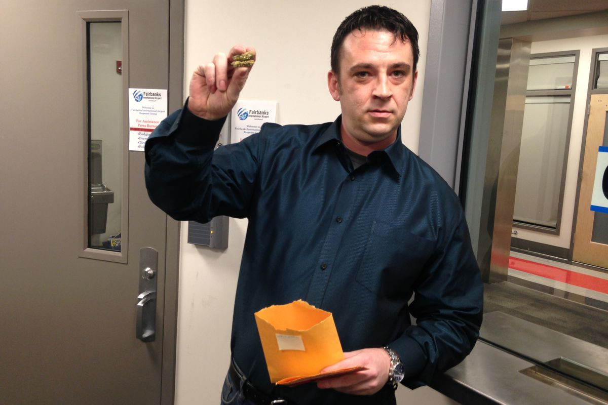 Frank Berardi of Fairbanks holds marijuana that had been surrendered at the Fairbanks airport in July, but was returned to him on Monday following a court order. (Laurel Andrews / Alaska Dispatch News)
