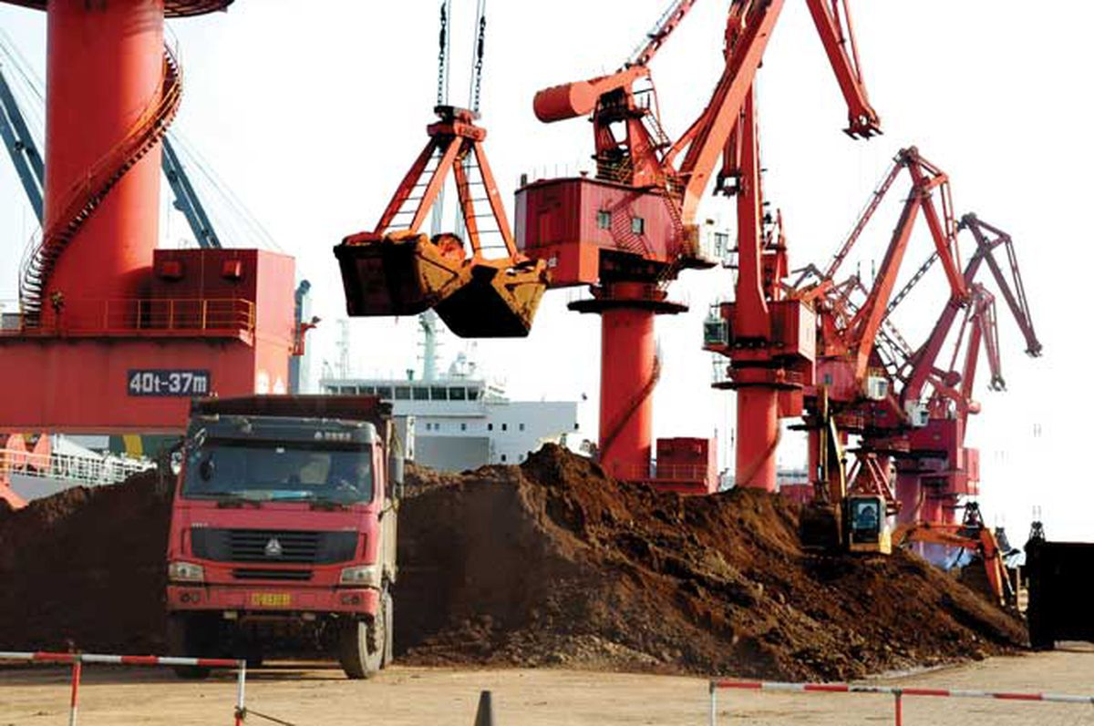 Excavators load rare earth elements onto trucks on a quay at the Port of Lianyungang, China, in November 2012. China controls 90 percent or more of the global supply of rare earths, which have a wide range of uses in high-tech sectors such as defense and renewable energy. Alaska has potential for domestic sources of rare earths, and the developers of a project on Prince of Wales Island are still advancing plans for production in Ketchikan. (Photo/Zhang Wei/AP)