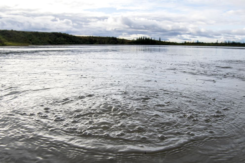 Methane gas released from seep holes at the bottom Esieh Lake ripples the surface. MUST CREDIT: Washington Post photo by Jonathan Newton