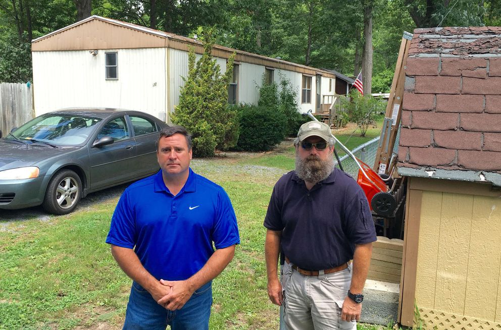 Special Agent Jay Perry of the Virginia State Police and Lt. Wally Stotlemyer stand in front of a home where a woman overdosed in November 2013. Their task force's work led to the arrest of the dealer. (Del Quentin Wilber/Los Angeles Times/TNS)