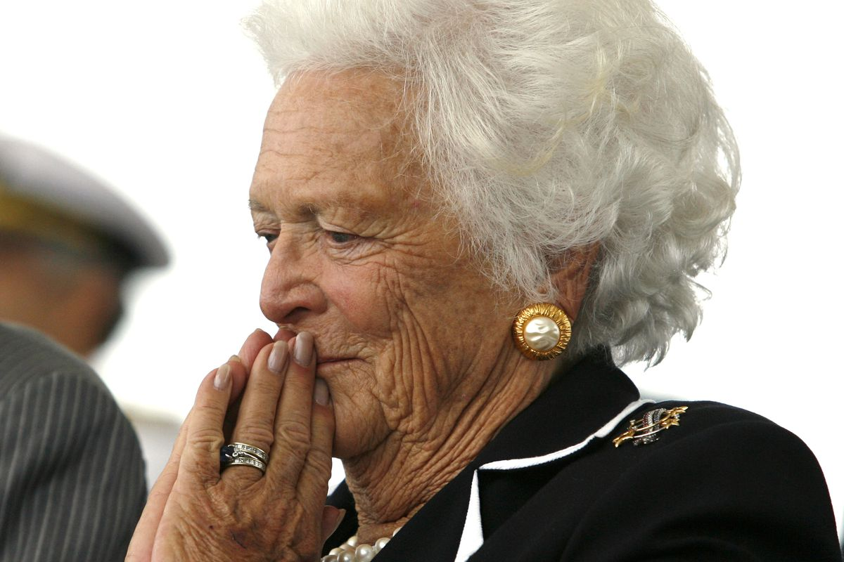 Former first lady Barbara Bush listens to remarks during the christening ceremony of the USS George H.W. Bush at Northrop-Grumman's shipyard in Newport News, Virginia, U.S., October 7, 2006. REUTERS/Kevin Lamarque/File Photo