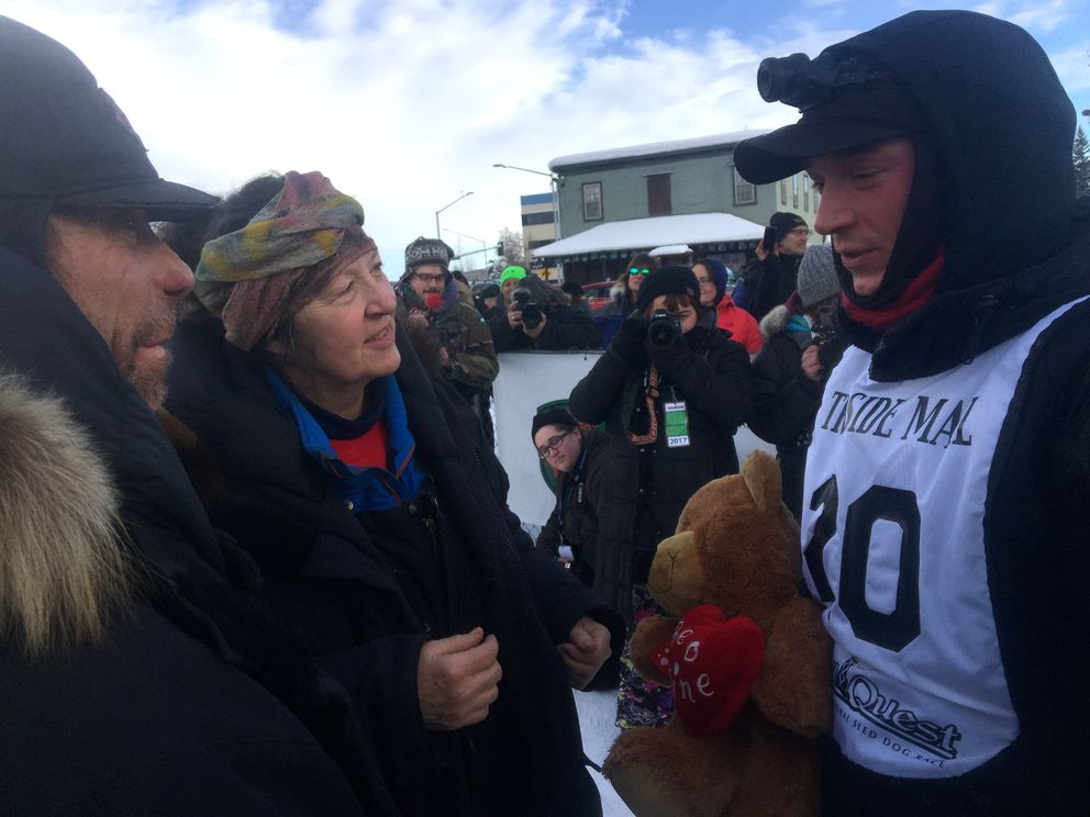Wayne and Scarlett Hall catch up with their son Matt after he won the Yukon Quest Tuesday at noon in Fairbanks. (Dermot Cole/Alaska Dispatch News)