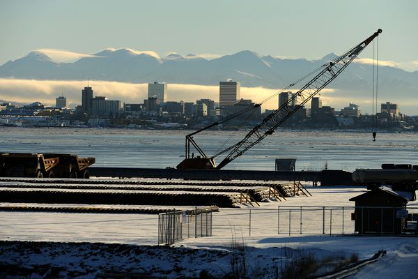It is just a short trip from Port MacKenzie in the Matanuska-Susitna Borough to downtown Anchorage, AK on Friday, January 30, 2015. The 195-foot twin-hulled vessel -- billed as the world's only icebreaking catamaran, built by the Office of Naval Research as a beach-landing prototype and then handed it over to the Mat-Su to start ferry service in Cook Inlet was supposed to provide vehicle and passenger service crossing Knik Arm. The ferry is docked in southeast Alaska and is not likely to ever see service on Knik Arm. (Bob Hallinen / Alaska Dispatch News)