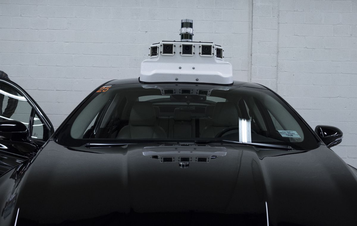 A Ford vehicle that will eventually be made into a self-driving car is outfitted with cameras at the Ford terminal in Washington, D.C. Washington Post photo by Calla Kessler