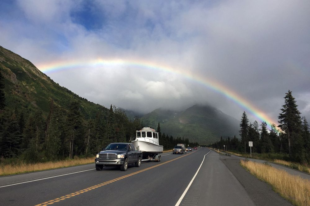 A rainbow brightens the drive for Seward Highway motorists early Tuesday evening, August 2, 2016, on the south side of Turnagain Pass. (Erik Hill / Alaska Dispatch News)