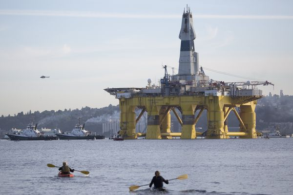 The Polar Pioneer oil rig leaves Seattle with tug boats pulling it away from Terminal 5, Monday, June 15, 2015. The U.S. Coast Guard says it has detained several protesters in kayaks Monday who tried to block Royal Dutch Shell's drill rig as it leaves Seattle on its way to explore for oil in the Arctic Ocean.