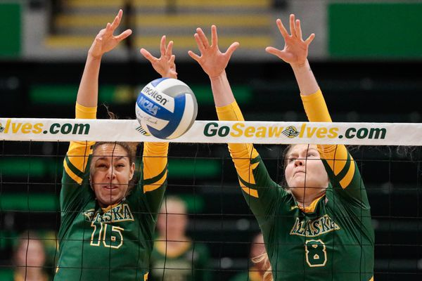 UAA's Eve Stephens and Jalisa Ingram block a shot during a volleyball game against the Concord Mountain Lions Friday, Sept. 6, 2019 at the Alaska Airlines Center. (Loren Holmes / ADN)