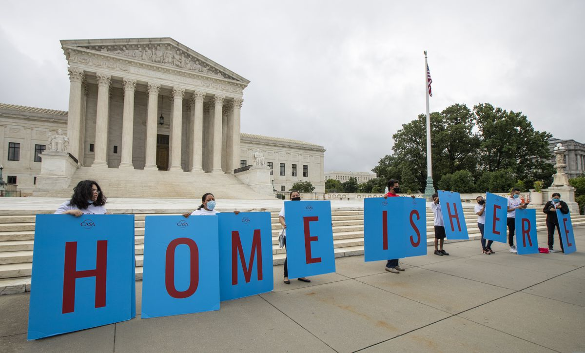 Deferred Action for Childhood Arrivals (DACA) students gather in front of the Supreme Court on Thursday, June 18, 2020, in Washington. President Donald Trump signed a memorandum Tuesday that seeks to bar people in the U.S. illegally from being counted in congressional reapportionment. (AP Photo/Manuel Balce Ceneta)