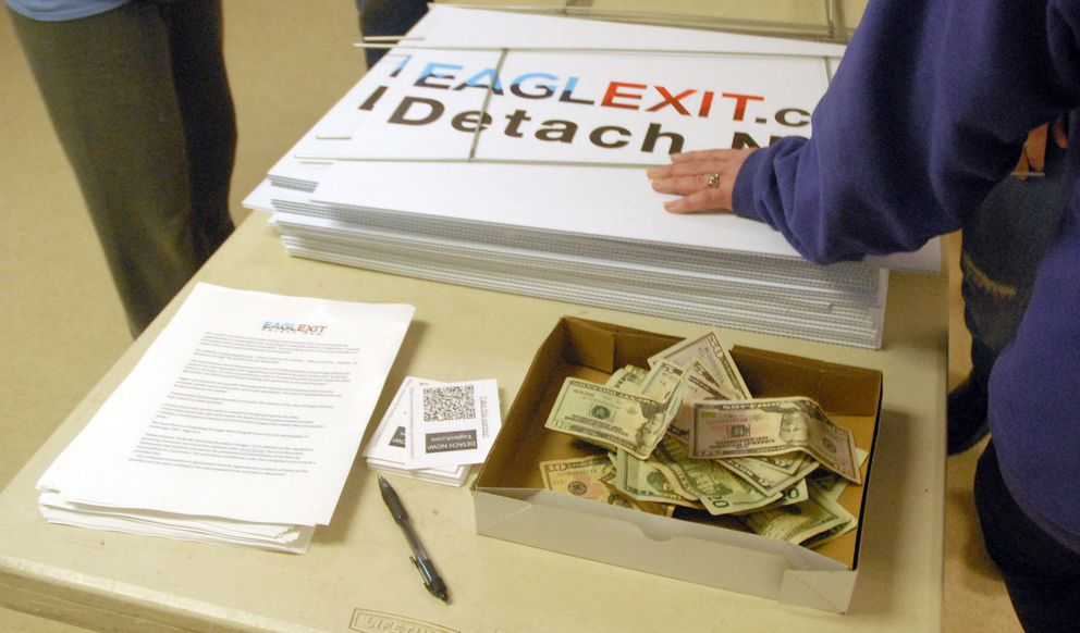 A box set up for donations following a meeting of the EaglExit group on Friday, May 3, 2019 at the Eagle River Lions Club. About 100 people attended the meeting, which was organized by a group hoping to detach the district from the Municipality of Anchorage. (Matt Tunseth / Chugiak-Eagle River Star)