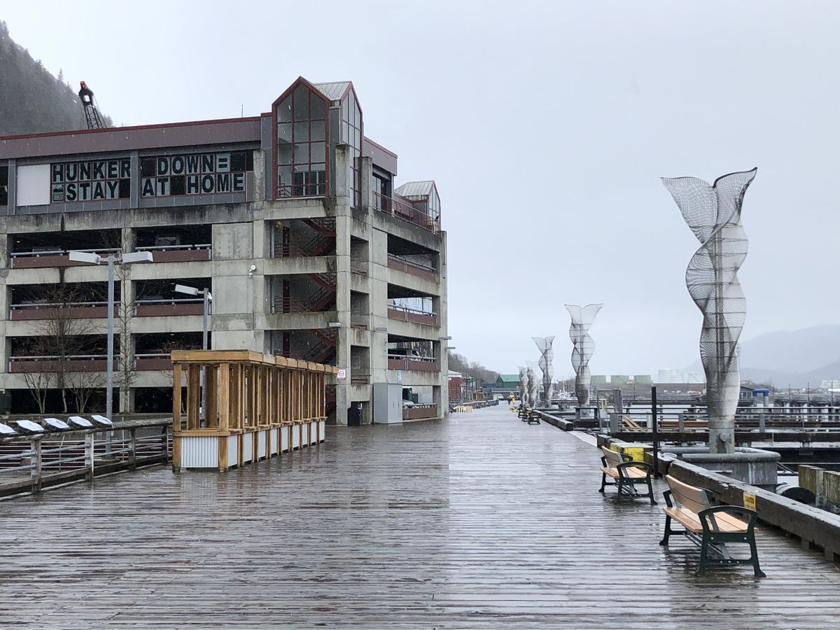Juneau's cruise ship docks are seen empty on Monday, April 27, 2020, as the downtown Juneau Public Library displays a message urging residents to stay at home. (James Brooks / ADN)