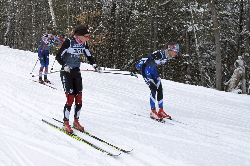Anchorage skier Jessica Yeaton, right, passes Kaelyn Woods on a downhill during Thursday's 10K classic race at the U.S. Cross Country Championships in Craftsbury, Vermont. Yeaton finished second to claim the silver medal. (AP Photo/Lisa Rathke)