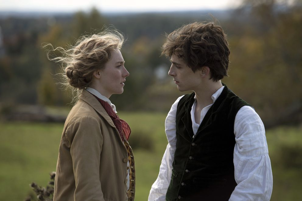 This image released by Sony Pictures shows, Saoirse Ronan and Timothée Chalamet in a scene from 'Little Women. ' (Wilson Webb/Sony Pictures via AP)