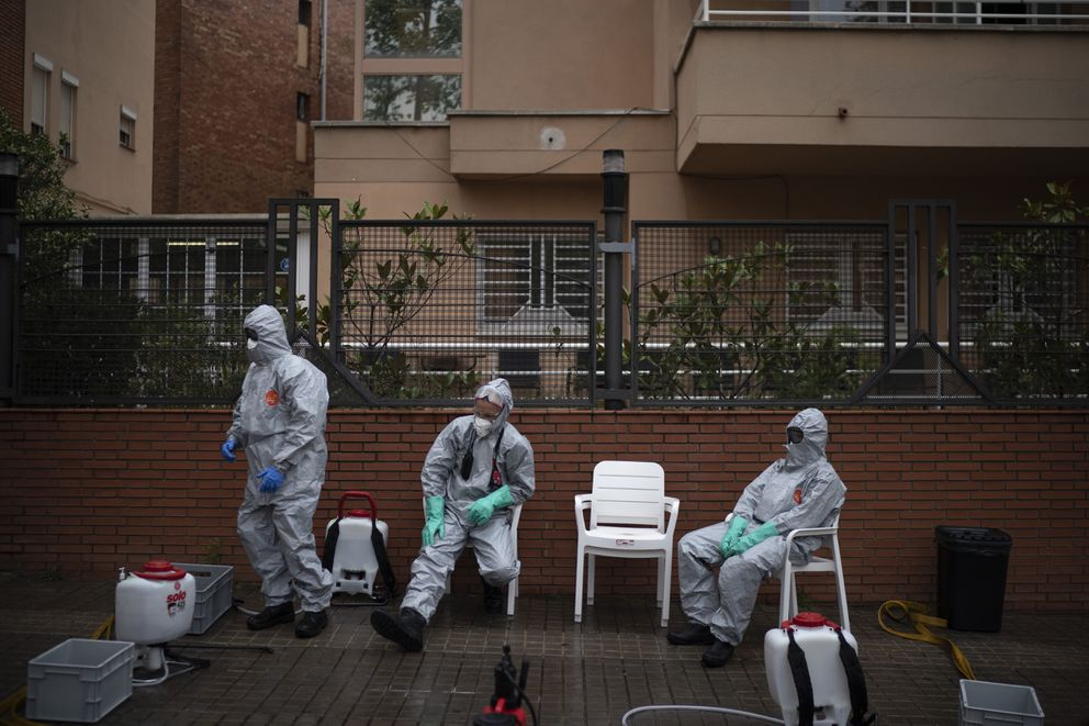 Ffirefighters wearing protective suits wait outside a nursing home before disinfecting it in efforts to prevent the spread of the new coronavirus in Barcelona, Spain, Monday, March 30, 2020. Governments in Europe's hardest-hit countries have yet to systematically test the residents of nursing homes or those who receive in-home care. In Spain, Italy and France, which together account for a third of the world's confirmed coronavirus cases, no one knows for sure how many people have become sick and died of coronavirus, especially among the elderly. (AP Photo/Felipe Dana)