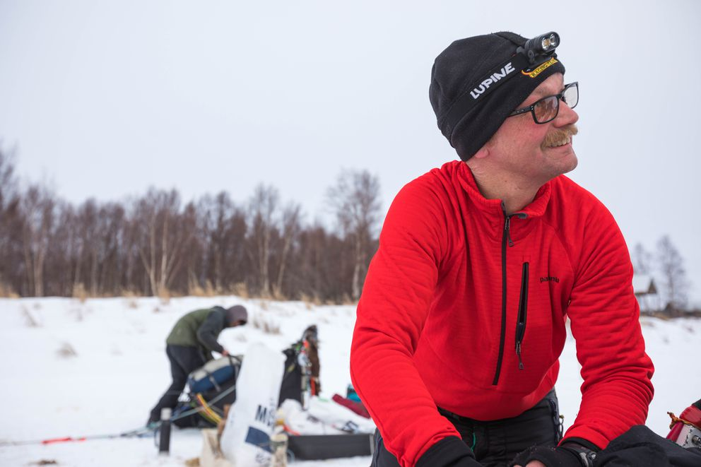 Mitch Seavey packs his sled at the checkpoint of Iditarod on Thursday. (Loren Holmes / ADN)
