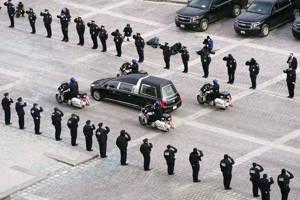 A hearse leaves the Capitol with the cremated remains of U.S. Capitol Police officer Brian Sicknick after he was lying in honor at the U.S Capitol, Wednesday, Feb. 3, 2021, in Washington. (Kevin Dietsch/Pool via AP)