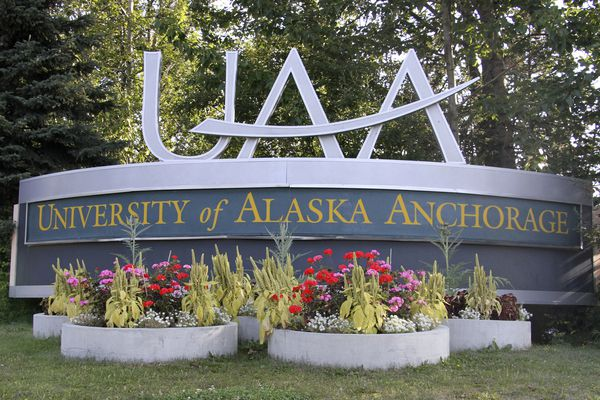 FILE - This Aug. 12, 2019, file photo shows a University of Alaska Anchorage sign in Anchorage, Alaska. Anyone with unpaid parking fines at the university has the option to reduce or cover the cost of their tickets with peanut butter and jelly. KTUU-TV reported the university would take donations for their annual payment tradition until Nov. 8 to help combat student hunger. University officials say each person could use PB&J payments for two citations issued within the past 45 days. (AP Photo/Mark Thiessen, File)