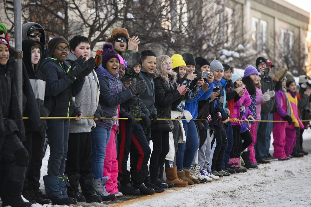 Students from Chester Valley Elementary School cheer mushers at last winter's Fur Rendezvous Open World Championship Sled Dog Race in Anchorage. (Marc Lester / ADN)