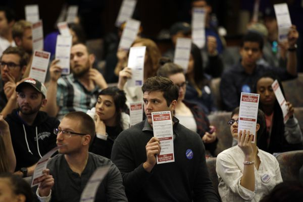 Pictured: Presidential preference cards are held up as votes are counted during a Democratic caucus at the University of Nevada, Reno, on Feb. 20, 2016.