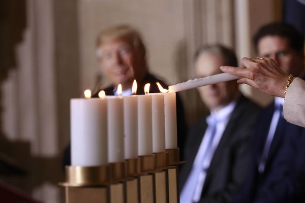 Candles are lit during a Holocaust Remembrance Day ceremony where President Donald Trump spoke, inside the U.S. Capitol, in Washington, April 25, 2017. (Doug Mills/The New York Times)