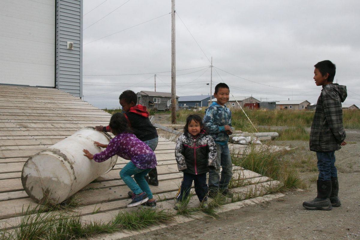 Children in the Southwestern Alaska village of Hooper Bay play on Thursday, Aug. 11, 2016. (Lisa Demer / Alaska Dispatch News)
