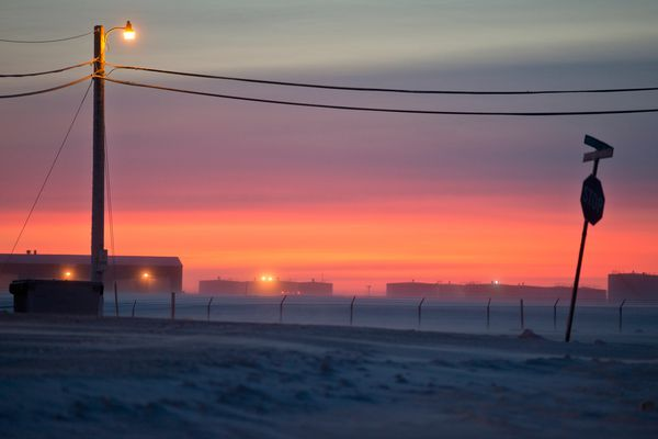 Midday light glows on the southern horizon as seen from Utqiagvik, formerly Barrow, on December 14, 2016. Utqiagvik is the northernmost community in the United States. (Marc Lester / ADN archive)