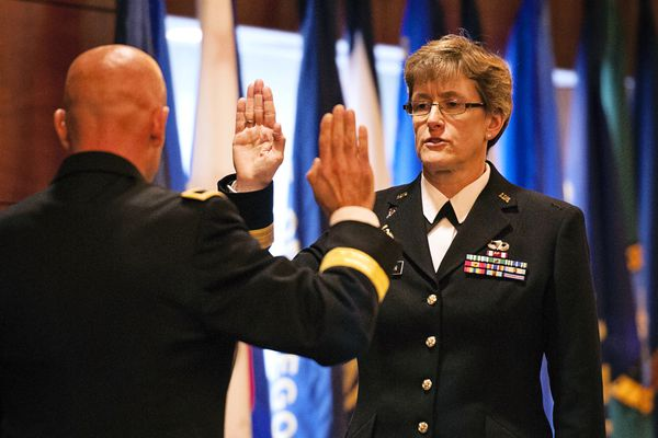 Brig. Gen. Catherine F. Jorgensen, chief of staff, Alaska Army National Guard, is pictured in this Sept. 2013 file photo reciting her oath of office. Jorgensen is suing to stop her termination in October in connection with a scandal that rocked the guard.