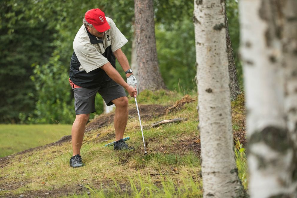 Jeff Greenwood hits the ball out of the woods. (Loren Holmes / ADN)