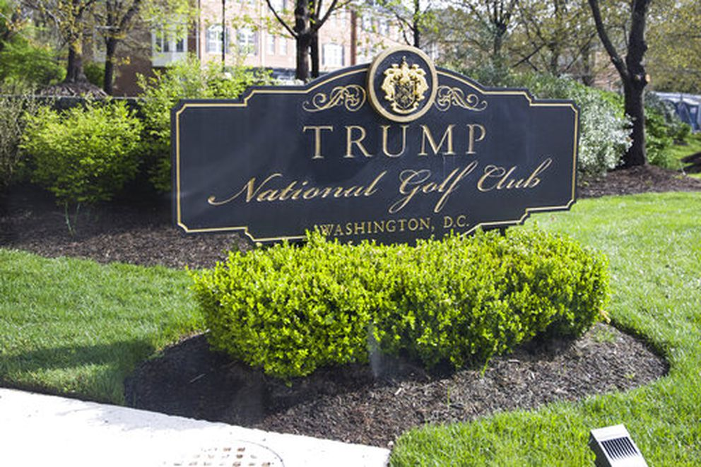 The sign for Trump National Golf Club as seen from the press pool van as the motorcade for President Donald Trump arrives, Saturday, April 13, 2019, in Sterling, Va. (AP Photo/Alex Brandon)