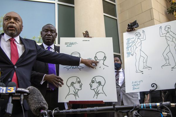Attorneys for the family of Andrew Brown Jr., Wayne Kendall, left, and Ben Crump hold a news conference Tuesday, April 27, 2021 outside the Pasquotank County Public safety building in Elizabeth City, N.C., to announce results of the autopsy they commissioned. The attorneys say an independent autopsy shows that Brown, a Black man, was shot five times, including in the back of the head. Brown was shot Wednesday by deputies serving drug-related search and arrest warrant. (Travis Long/The News & Observer via AP)