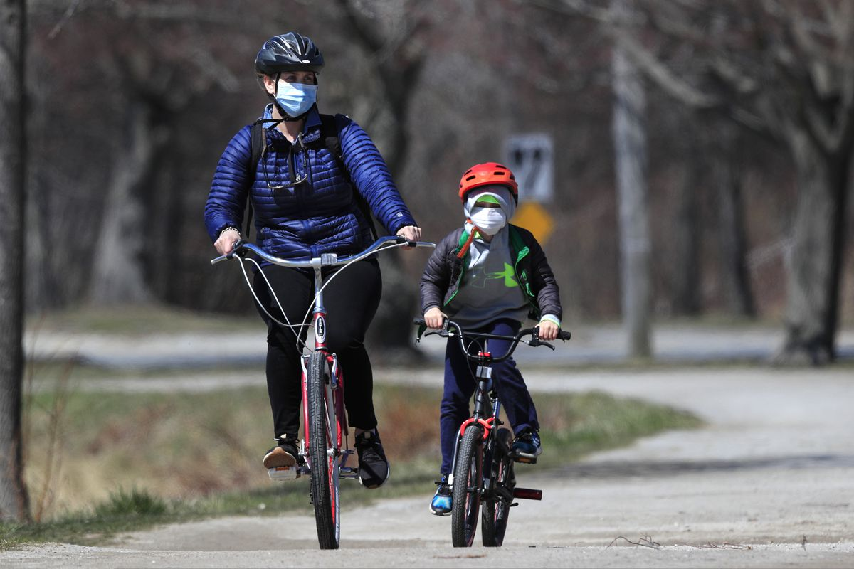 Bicyclists wear pandemic masks while riding in Portland, Maine. (AP Photo/Robert F. Bukaty)